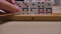 Dominoes in Row Man Playing Game, 4K Stock Footage