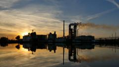 Sunset over oil refinery - timelapse Stock Footage