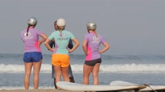 Surf school students and instructor on beach,Kuta,Bali,Indonesia Stock Footage
