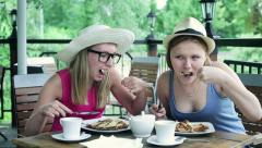 Two girlfriends eating pancake in restaurant Stock Footage