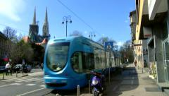 Zagreb cathedral from the back and a tram passing by Stock Footage