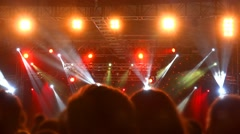 4k Stage Spotlight with Laser reflectors and silhouette spectators crowd - stock footage