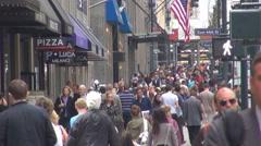 Crowded sidewalk New York City pedestrian people commute day Manhattan avenue US Stock Footage