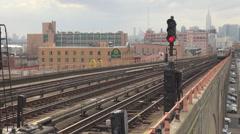 Subway train depart suburban station Manhattan skyline New York City foggy day   Stock Footage