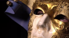 Man in carnival mask stares into camera Stock Footage