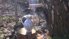 Birch tree sap dripping in decorative jug through woodenspigot Stock Footage