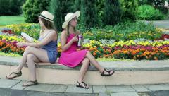Girfriends offended in the park Stock Footage