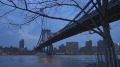 Traffic car ferry cruise Manhattan Bridge New York City twilight tourism emblem  Stock Footage