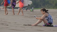 Woman reads a book on the beach,Kuta,Bali,Indonesia - stock footage