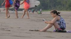 Woman reads a book on the beach,Kuta,Bali,Indonesia Stock Footage