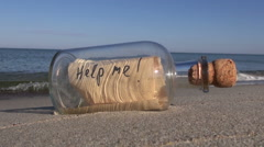 Vintage bottle with a message on ocean beach Stock Footage