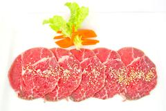 High grade sliced Hida wagyu beef isolated on white background Stock Photos