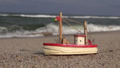 Wooden nautical  ship toy model on the beach Stock Footage