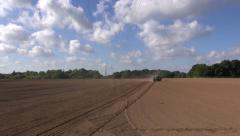 Agriculture tractor  sowing seeds on farm field Stock Footage