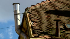 An old rusty and a new shiny metal chimneys in timelapse Stock Footage