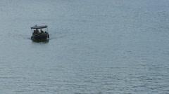One boat floating on Vltava River, Prague Stock Footage