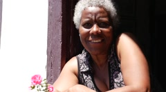 Brazilian Woman Smiles in a Window in a Typical House in Brazil Stock Footage