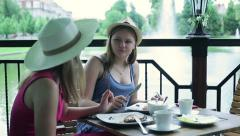 Girlfriends talking and eating pancakes in cafe Stock Footage