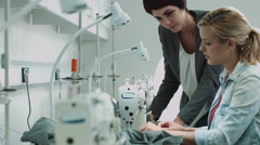 Fashion designers at sewing machine working together Stock Footage