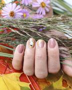 Beautiful nails with art - stock photo
