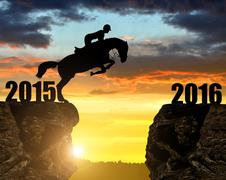 The rider on the horse jumping into the New Year 2016 - stock photo