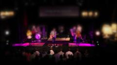 Tilt shift lens concert rocking out worship Stock Footage