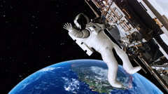 Astronaut working on the international space station waving - 4K - stock footage