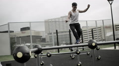 4K Very fit Asian man working out in outdoor urban environment Stock Footage