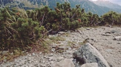 Camera flying over the edge of cliff to the mountain lake view, Stabilized POV. Stock Footage
