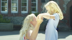 4K Happy little girl greets her mother after finishing school for the day Stock Footage