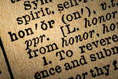 Close-up of the word HONOR and its definition - stock photo