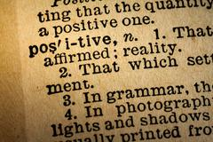 Close-up of the word POSITIVE and its definition - stock photo