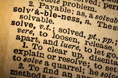 Close-up of the word SOLVE and its definition - stock photo