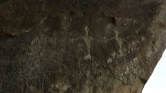 Historical petrographs. Carvings dating back 10 000 BC in Gobustan,Azerbaijan  - stock footage