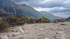 Flying over the edge of cliff to the mountain lake view, Stabilized Slow-Mo POV - stock footage
