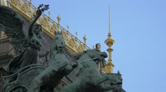 Angel with horses statue on top of the National Theatre in Prague Stock Footage