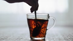 prevent sugar glass cup of tea - stock footage