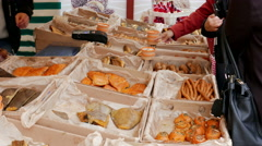Open air food market. People buying smoked fish Stock Footage