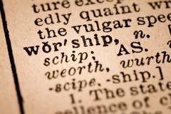 Close-up of an Opened Dictionary showing the Word WORSHIP - stock photo