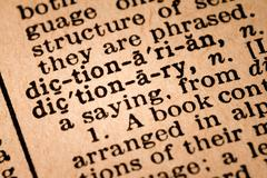 Close-up of an Opened Dictionary showing the Word DICTIONARY - stock photo