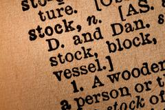 Close-up of an Opened Dictionary showing the Word STOCK - stock photo