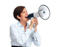 Happy woman talking in megaphone. - stock photo
