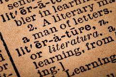 Close-up of an Opened Dictionary showing the Word LITERATURE - stock photo