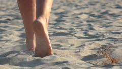 4k Woman walking on sand, footsteps in sand, Back view - stock footage