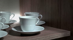 Showing tea and coffee cups on a shelf Stock Footage