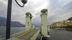 Ferry steamboat transporting people and cars on the Como Lake in Bellagio, Italy Stock Footage