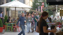 Tourists walking near the outdoor restaurants in Prague Stock Footage