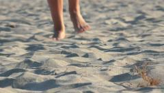 4k Woman walking on sand, footsteps in sand, Front view - stock footage