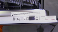 Different buttons and features on a dishwasher Stock Footage