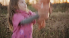 Little girl throws up doll Stock Footage